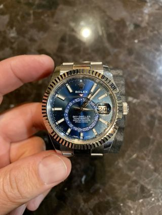 Rolex Sky - Dweller,  Blue Dial,  White Gold Fluted Bezel Box & Papers